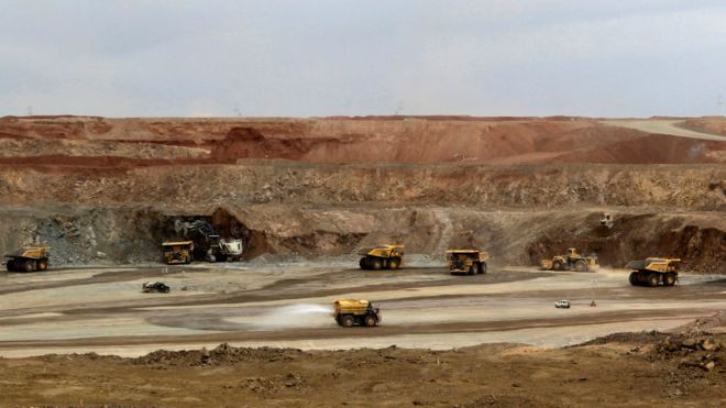 161201081318_mining_trucks_are_seen_at_the_oyu_tolgoi_mine_in_south_gobi_region_.jpg